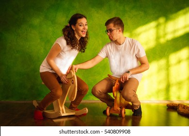 Man tries to take toy horse from his woman playing with it