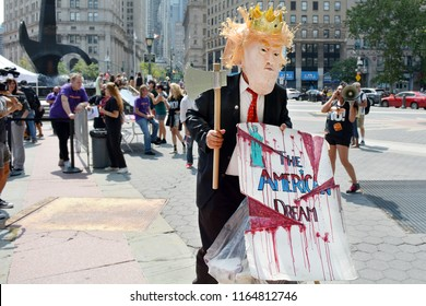 Man In Trump Costume With Sign at Anti Kavanaugh Protest In Foley Square, New York, NY, USA on August 26th, 2018