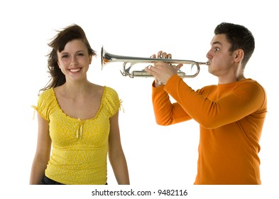 The man trumpet straight to the woman ear. She's smiling and looking at camera. White background.