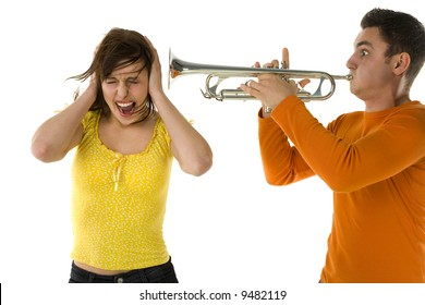 The man trumpet straight to the woman ear. She covering ears and creaming. White background.