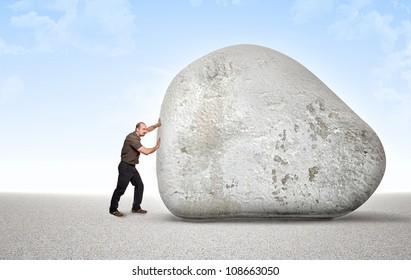 man try to move an huge stone