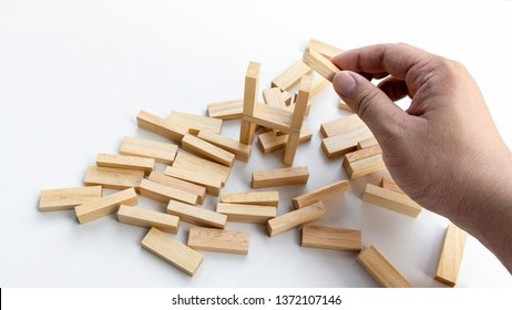 A Man try to rebuild assembly wooden block again after broken