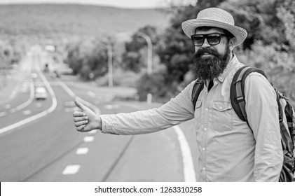 Man try stop car thumb up. Pick me up. Hitchhiking one of cheapest ways traveling. Picking up hitchhikers. Hitchhikers risk being picked up by someone who is unsafe driver or personally dangerous.