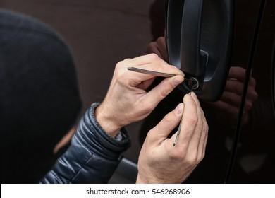 Man trying to break into car, closeup
