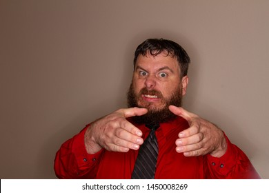 man trying to choke something with his hands