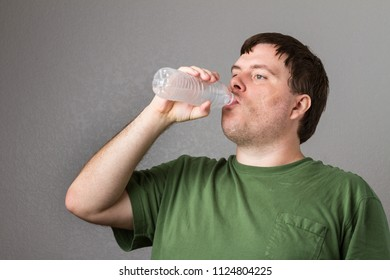 man trying to drink water on a nice hot day