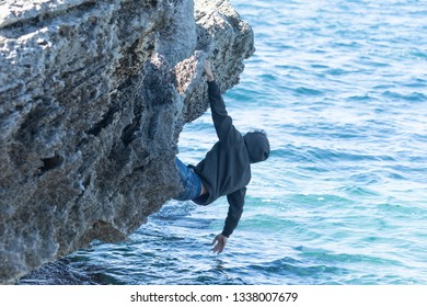 Man trying not to fall into the water so as not to drown in the water.concept of climbing
