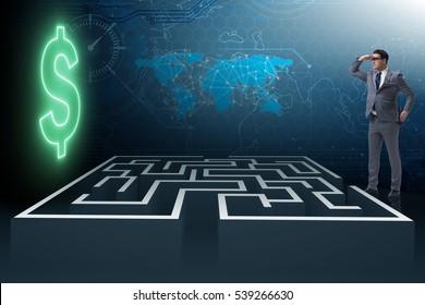 Man trying to reach dollars through maze