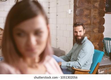Man trying to seduce beautiful shy woman. Date, love, romance, dating