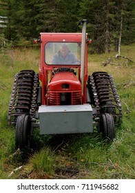 Man trying to start an old abandoned tractor