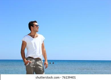 man with tshirt posing at the beach