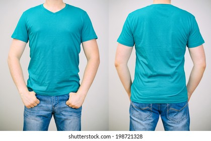 Man in turquoise t-shirt. Grey background.