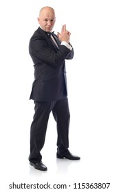 Man in tuxedo in a 007 james bond pose