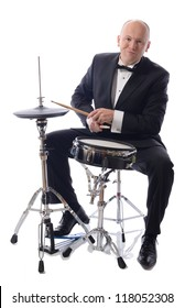 man in tuxedo playing drums isolated on white