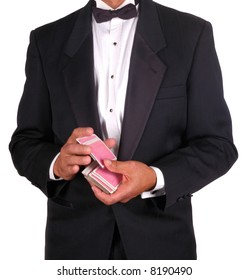 Man in Tuxedo Shuffling a Deck of Cards isolated over white