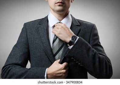 man in a tuxedo tie tightens