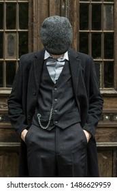 Man in twenties style. Peaky blinders photossesion. Mafia old Birmingham.