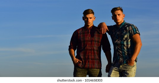 Man twins with athletic body, family values. Fashion for men, summer. Future and freedom, support and trust. Men twins in sunset or sunrise, friendship. Twin brothers man, relations, copy space