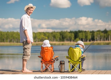 man and two sons on fishing, father teaches children to fish