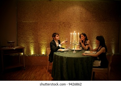 a man and two woman at restaurant