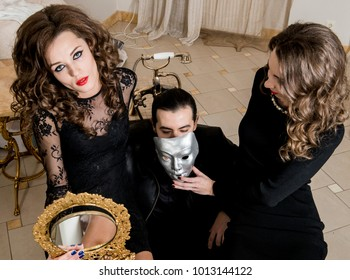 Man and two women, strange company