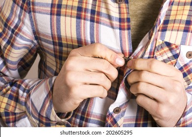 Man tying his shirt on a white background
