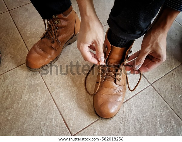 Man tying shoelaces.
