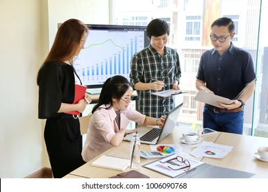 Man Typing Keyboard Laptop Hand. Business Team Working Startup modern Office.Global Strategy Virtual Icon. Innovation Graphs Interfaces. Asian business team negotiating discussing work. workmates life