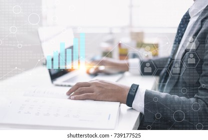 Man Typing Keyboard Laptop Hand with digital graph interface, Project Manager Researching Process and Analyze market stock.