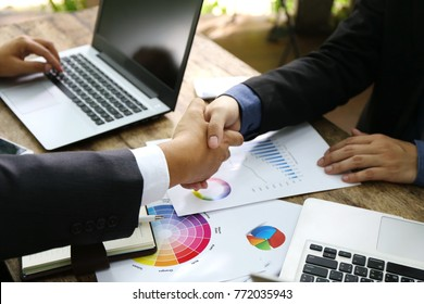 Man Typing Keyboard Laptop Hand. Business Team Working Startup modern Office.Global Strategy Virtual Icon.Innovation Graphs Interfaces. Asian business team discussing work in building hallway unit