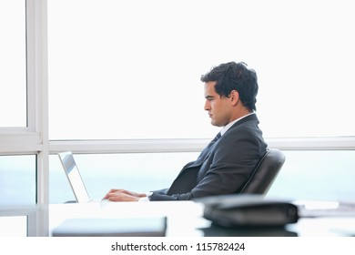 Man typing on a computer in an office
