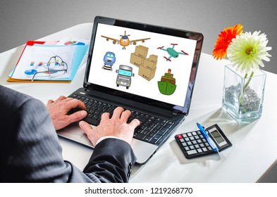 Man typing on a laptop showing a transportation concept