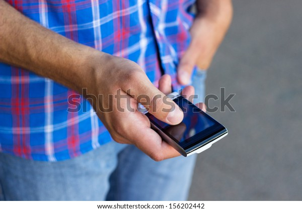 Man typing text message