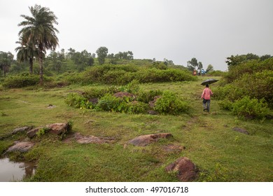 Man with an umbrella during monsoon season in Jharkhand, India