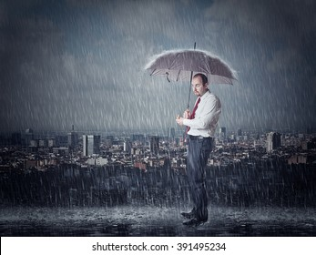 man with umbrella and heavy rain urban background
