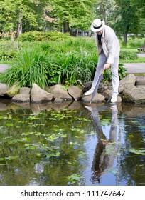 man with umbrella in park