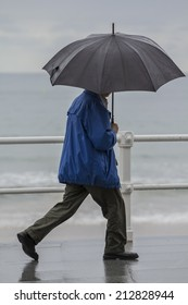 Man with umbrella walking in the city