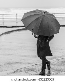 Man with umbrella walking on the city