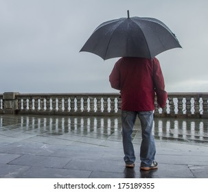 Man with umbrella and wave