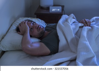A man unable to fall asleep in bed