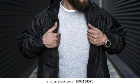 Man in an unbuttoned black jacket. Streetwear. Life style. Fashion background