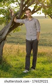 Man under tree at field