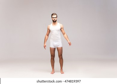 Man in underwear. Full length studio shot of handsome young man in underwear looking at camera