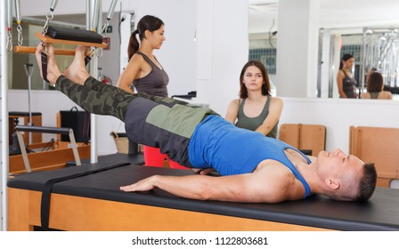 man in uniform in the gym for rehabilitation