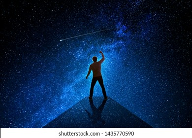 Man with universe background celebrating a success