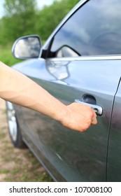 Man unlock grey car door by key
