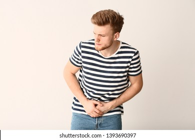 Man with urologic disease on white background