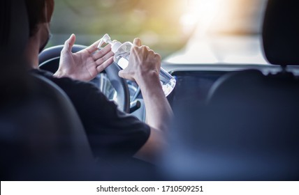 Man use alcohol gel 70% cleaning hand in car to protect corona virus 2019 or Covid 19