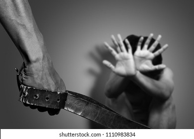 man use belts to hit and injure the others. campaign to stop using violence against others concept.
