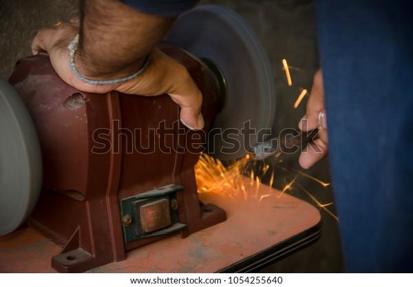 Strange Man Use Bench Grinder Sharpening Wick Stock Photo Edit Now Ncnpc Chair Design For Home Ncnpcorg